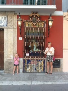Ellie & Laurie in front of a shrine in Malaga