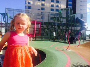 Ellie at playground in Barcelona