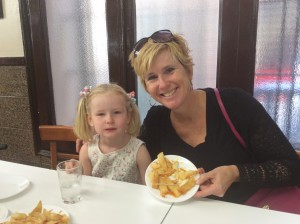 Ellie and Laurie having patatas bravas at a famous local place at Bar Thomas